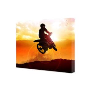 Obraz na płótnie sylwetka mężczyzny na motocross